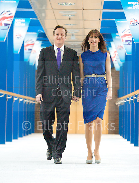 Conservative Party Conference, ICC, Birmingham, Great Britain <br /> 10th October 2012 <br />  Day 4<br /> <br /> Rt Hon David Cameron MP <br /> and Samantha Cameron <br /> walking to the Conference centre prior to his leaders' speech <br /> <br /> <br /> Photograph by Elliott Franks<br /> <br /> United Kingdom<br /> Tel 07802 537 220 <br /> elliott@elliottfranks.com<br /> <br /> &copy;2012 Elliott Franks<br /> Agency space rates apply