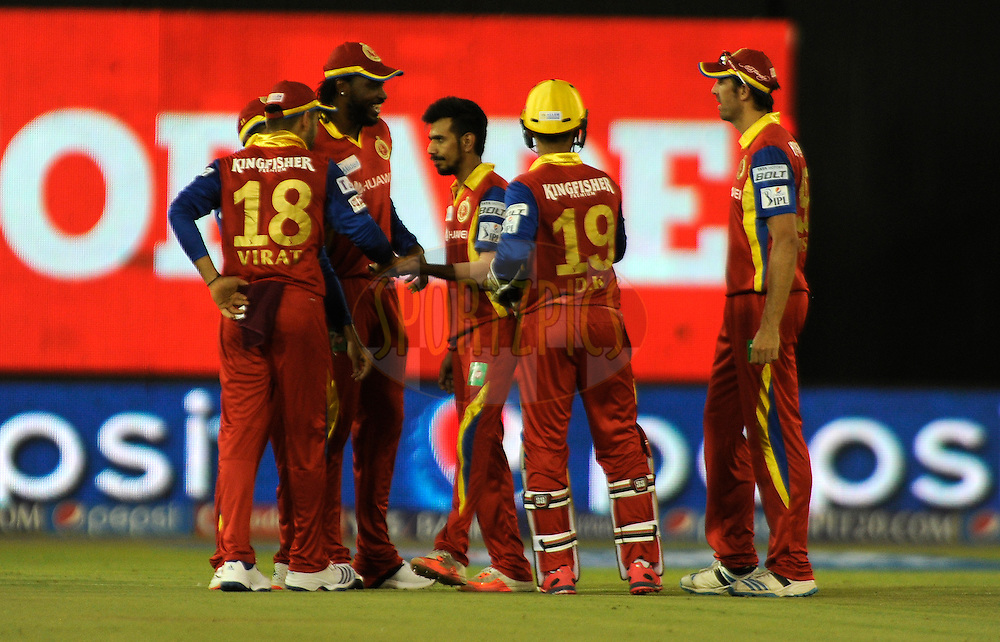 Yuzvendra Chahal of Royal Challengers Bangalore celebrates the wicket of Sanju Samson of Rajasthan Royals during match 22 of the Pepsi IPL 2015 (Indian Premier League) between The Rajasthan Royals and The Royal Challengers Bangalore held at the Sardar Patel Stadium in Ahmedabad , India on the 24th April 2015.<br /> <br /> Photo by:  Pal Pillai / SPORTZPICS / IPL