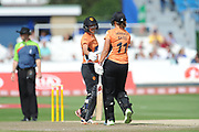 Sara McGlashan of Southern Vipers congratulates Suzie Bates on reaching her half century during the Women's Cricket Super League match between Southern Vipers and Surrey Stars at the 1st Central County Ground, Hove, United Kingdom on 14 August 2018.