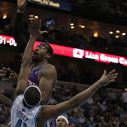 Nov 19, 2009; New Orleans, LA, USA;  Phoenix Suns forward Amare Stoudemire (1) shoots over New Orleans Hornets forward James Posey (41) during the second half at the New Orleans Arena. The Hornets defeated the Suns 110-103. Mandatory Credit: Derick E. Hingle-US PRESSWIRE