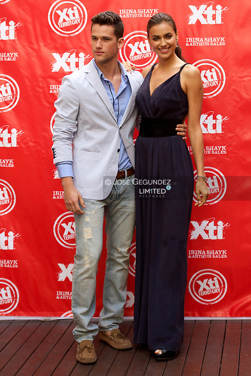 Models Irina Shayk and Arthur Sales launch the new 'Xti' shoes new Autum-Winter 2012-2013 collection at the Hospes Hotel in Madrid, Spain