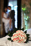 Bride and groom and wedding bouquet