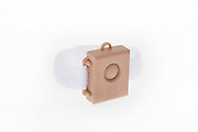 Cutout of a wrist distress alarm panic button on white background This panic button is worn by elderly people on their wrist to activate an alarm in case of need