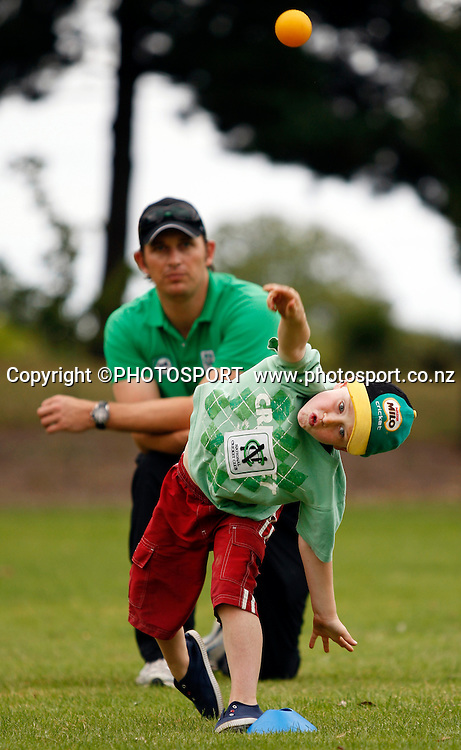 Shane Bond watches Nicholas Gibb (6) during the junior bowling practice during the National Bank Super Camp, a National Bank initiative to connect with cricket's grass roots. Held at the East Shirley Cricket Club, Christchurch, New Zealand. Thursday, 27 January 2011. Joseph Johnson / PHOTOSPORT.