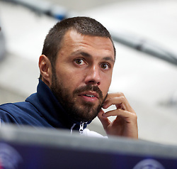 MANCHESTER, ENGLAND - Wednesday, September 14, 2011: SSC Napoli's Andrea Dossena looks on from the substitute's bench during the UEFA Champions League Group A match at the City of Manchester Stadium. (Photo by Chris Brunskill/Propaganda)