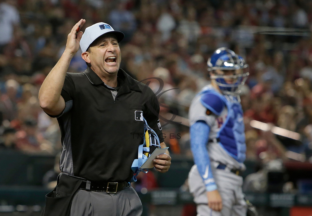 MLB umpire Jim Reynolds (77) ejects New York Mets relief pitcher Jason Vargas in the fourth inning during a baseball game against the Arizona Diamondbacks, Sunday, June 17, 2018, in Phoenix. Vargas was on the bench and not in the game. (AP Photo/Rick Scuteri)