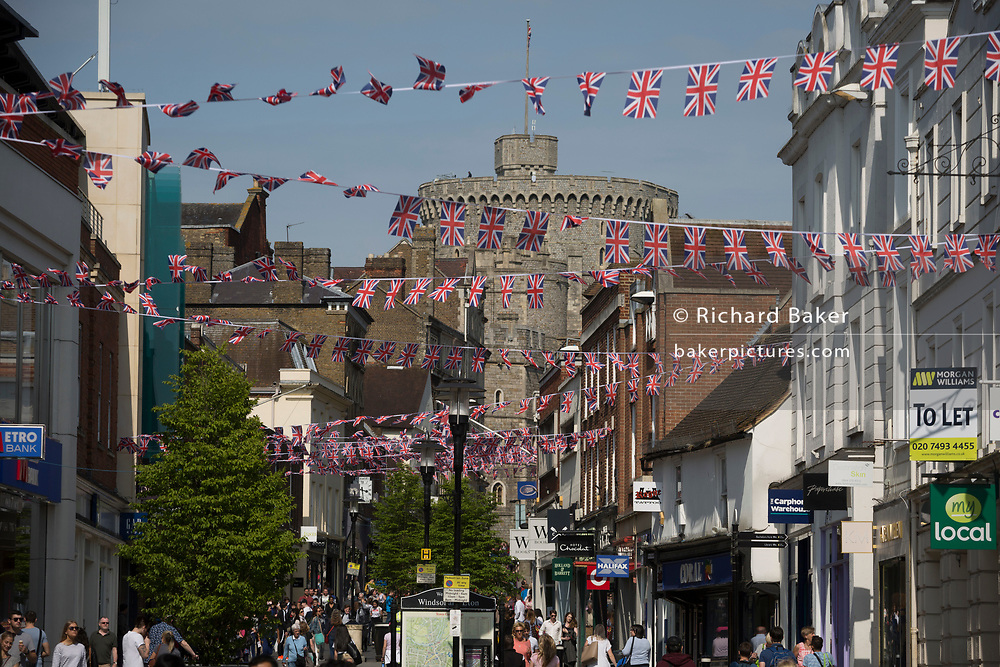Union jack bunting hangs between shops as the royal town of Windsor gets ready for the royal wedding between Prince Harry and his American fiance Meghan Markle, on 14th May 2018, in London, England. (Photo by Richard Baker / In Pictures via Getty Images)