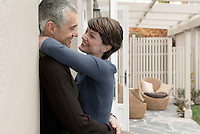 Smiling couple embracing on patio