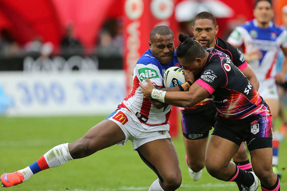 Akuila Uate of the Newcastle Knights,left, is tackled by Solomone Kata of the New Zealand Warriors during their round 12 NRL match at Mount Smart Stadium, Auckland on  Sunday, May 31, 2015. Credit: SNPA / David Rowland