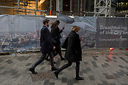 Businesspeople walk through rain under umbrellas on Lime Street in the City of London, the capital's financial district, 7th March 2018, in London England.