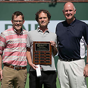 Matt Cronin is presented with the BNP Paribas Open Media Award by Director of Media, Matt Van Tuinen, and Tournament Director, Steve Simon, on stadium 1 at the Indian Wells Tennis Garden in Indian Wells, California on Tuesday, March 17, 2015.<br /> (Photo by Billie Weiss/BNP Paribas Open)