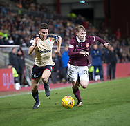 12th December 2017, Tynecastle Park, Edinburgh, Scotland; Scottish Premier League football,  Heart of Midlothian versus Dundee; Dundee's Cammy Kerr takes on Hearts' Lewis Moore