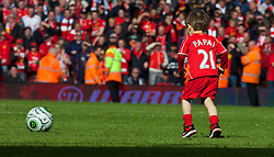 LIVERPOOL, ENGLAND - Sunday, May 11, 2014: Pedro Lucas, so of Liverpool's Lucas Leiva on the pitch after the Premiership match at Anfield. (Pic by David Rawcliffe/Propaganda)