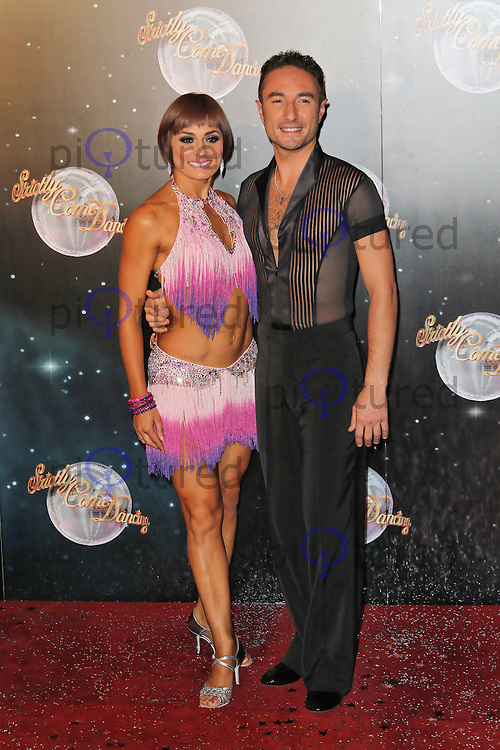 LONDON - SEPTEMBER 11: Flavia Cacace; Vincent Simone attended the Strictly Come Dancing Launch at the BBC Television Centre, London, UK. September 11, 2012. (Photo by Richard Goldschmidt)