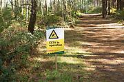 CCTV cameras in operation sign notice in forestry plantation, Rendlesham Forest, Suffolk, England, UK