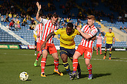 Oxford defender Cheyenne Dunkley takes on Stevenage midfielder Dale Gorman and Stevenage defender Luke Wilkinson during the Sky Bet League 2 match between Oxford United and Stevenage at the Kassam Stadium, Oxford, England on 25 March 2016. Photo by Alan Franklin.