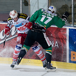 Ziga Pavlin (HDD Tilia Olimpija, #17) vs Thomas Hundertpfund (EC KAC, #27) during ice-hockey match between HDD Tilia Olimpija and EC KAC in 32nd Round of EBEL league, on December 28, 2010 at Hala Tivoli, Ljubljana, Slovenia. (Photo By Matic Klansek Velej / Sportida.com)