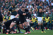 JOHANNESBURG, South Africa, 04 October 2014 : Aaron Smith of the All Blacks puts his backline away during the Castle Lager Rugby Championship test match between SOUTH AFRICA and NEW ZEALAND at ELLIS PARK in Johannesburg, South Africa on 04 October 2014. <br /> The Springboks won 27-25 but the All Blacks successfully defended the 2014 Championship trophy.<br /> <br /> © Anton de Villiers / SASPA