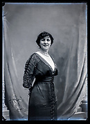 smiling self assured adult woman studio portrait France ca 1920s