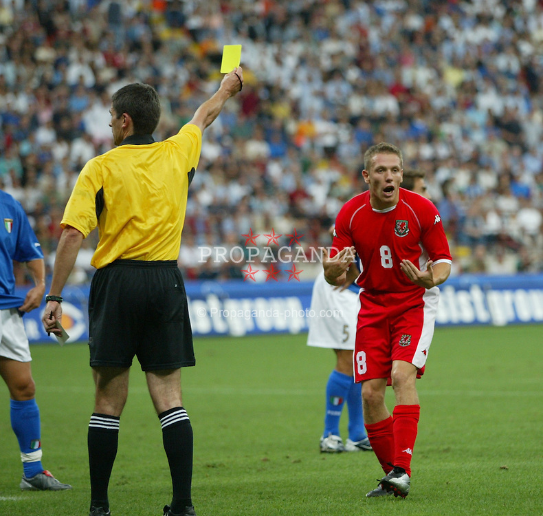 MILAN, ITALY - Saturday, September 6, 2003: Wales' Craig Bellamy can't believe he's been booked by referee Markus Merk against Italy during the Euro 2004 qualifying match at the San Siro Stadium. (Pic by David Rawcliffe/Propaganda)