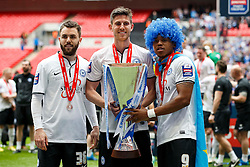 Peterborough Goalscorers Josh McQuoid (NIR), Shaun Brisley (ENG) and Britt Assombalonga (COD) hold the trophy after a 3-1 win - Photo mandatory by-line: Rogan Thomson/JMP - 07966 386802 - 30/03/2014 - SPORT - FOOTBALL - Wembley Stadium, London - Chesterfield FC v Peterborough United - Johnstone's Paint Trophy Final.