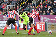 Lincoln City midfielder Danny Rowe (24) battles for possession with Exeter City midfielder Hiram Boateng (44)  during the EFL Sky Bet League 2 match between Lincoln City and Exeter City at Sincil Bank, Lincoln, United Kingdom on 30 March 2018. Picture by Mick Atkins.