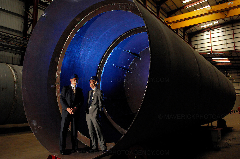 Jim Murphy announces £8 million funding for Scotland's European Marine Energy Centre (EMEC) as UK government rolls out Low Carbon Transition Plan...Picture shows Secretary of State for Scotland Jim Murphy (R) with CEO of Pelamis Wave Power Phil Metcalf at Pelamis' headquarters in Edinburgh inside one of the wave power turbines being built for E-On Power.