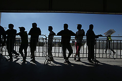 October 5, 2016 - Athens, Greece - Migrants and refugees wait to receive food at a sports facility at the former Athens airport site of Athens, Greece on October 5, 2016Almost 2,500 migrants and refugees, mainly Afghani, are housed at the former Athens airport site, and to an olympic complex used in the 2004 Olympics. In total 60.736 refugees and other migrants are stranded in Greece. (Credit Image: © Panayiotis Tzamaros/NurPhoto via ZUMA Press)