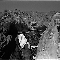 Women wear the burqa as they pass along the Panshir valley.  Women have to be covered at all times, even in areas controlled by the more lenient Northern Alliance, but in Taliban areas, they tempt death to show the slightest deviance from repressive tribal interpretation of Islam. (Greg Marinovich)