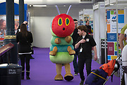 UNITED KINGDOM, London: 22 January 2019. 'The Hungry Caterpillar' walks through The Toy Fair 2019 which is being held at Olympia London this morning. The Toy Fair, which runs between 22nd-24th of January, is the UK's largest toy trade event with over 250 exhibiting companies launching thousands of new products. <br /> Rick Findler / Story Picture Agency