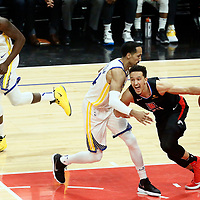 LOS ANGELES, CA - APR 26: Landry Shamet (20) of the LA Clippers drives past Shaun Livingston (34) of the Golden State Warriors during Game 6 of the Western Conference First Round on April 26, 2019 at the Staples Center, in Los Angeles, California.