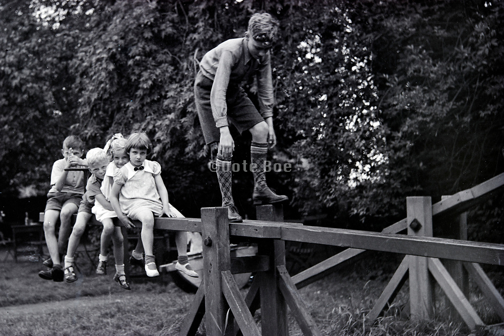 group of children playing on a large seesaw Netherlands 1950s