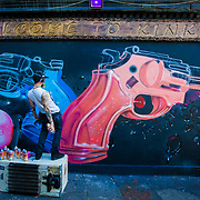 as part of the Meeting Of Style street art festival in Nomadic Community Garden in Shoreditch.<br /> Artist Fanakapan painting his piece titled &quot; water violence only&quot; <br /> Promoting water fights this summer<br /> Against all the pointless gang violence in London and around the world .