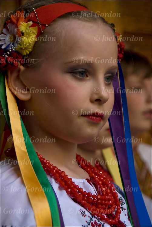 Waiting to go on stage, second and third generation Ukrainian American children celebrate their ethnic pride and culture dressed in folk costume to perform dances on stage at the St.George 34 th Annual Ukrainian Festival on May 16, 2010 in the East Village on East 7th Street.