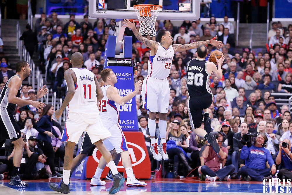18 February 2014: San Antonio Spurs shooting guard Manu Ginobili (20) goes for the layup past Los Angeles Clippers small forward Matt Barnes (22) during the San Antonio Spurs 113-103 victory over the Los Angeles Clippers at the Staples Center, Los Angeles, California, USA.