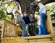 Timmy O'Brien, 7, left, tries out a back yard zip line while his father, author Tim O'Brien, brother, Tad, 7, and mother, Meredith, wait in the family tree house at their south Austin home on Tues., Oct. 30, 2012.<br /> Ashley Landis FOR AMERICAN STATESMAN