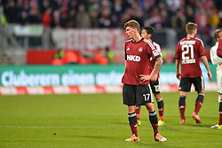08.02.2014, easyCredit Stadion, Nuernberg, GER, 1. FBL, 1. FC Nuernberg vs FC Bayern Muenchen, 20. Runde, im Bild Mike Frantz (1 FC Nuernberg) frustriert nach der Niederlage gegen den FC Bayern Muenchen Hinten rechts: Marvin Plattenhardt (1 FC Nuernberg) // during the German Bundesliga 20th round match between 1. FC Nuernberg and FC Bayern Munich at the easyCredit Stadion in Nuernberg, Germany on 2014/02/08. EXPA Pictures © 2014, PhotoCredit: EXPA/ Eibner-Pressefoto/ MERZ<br /> <br /> *****ATTENTION - OUT of GER*****