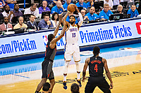 OKLAHOMA CITY, OK - APRIL 21: Paul George #13 of the Oklahoma City Thunder shoots a jump shot during a game against the Portland Trail Blazers during Round One Game Three of the 2019 NBA Playoffs on April 21, 2019 at Chesapeake Energy Arena in Oklahoma City, Oklahoma  NOTE TO USER: User expressly acknowledges and agrees that, by downloading and or using this photograph, User is consenting to the terms and conditions of the Getty Images License Agreement.  The Trail Blazers defeated the Thunder 111-98.  (Photo by Wesley Hitt/Getty Images) *** Local Caption *** Paul George