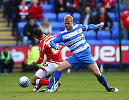 Matthew Mills (5) of Reading tackles Diego Arismendi (23) of Barnsley during the Npower Championship match between Reading and Barnsley on Saturday 25th September 2010 at the Madejski Stadium, Reading, UK. (Photo by Andrew Tobin/Focus Images)