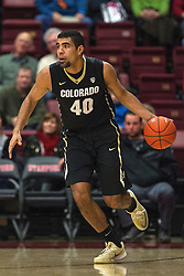 Colorado forward Josh Scott (40) dribbles the ball against Stanford during the first half of an NCAA college basketball game in Stanford, Calif., Sunday, Jan. 3, 2016. Colorado won 56-55. (AP Photo/Jason O. Watson)