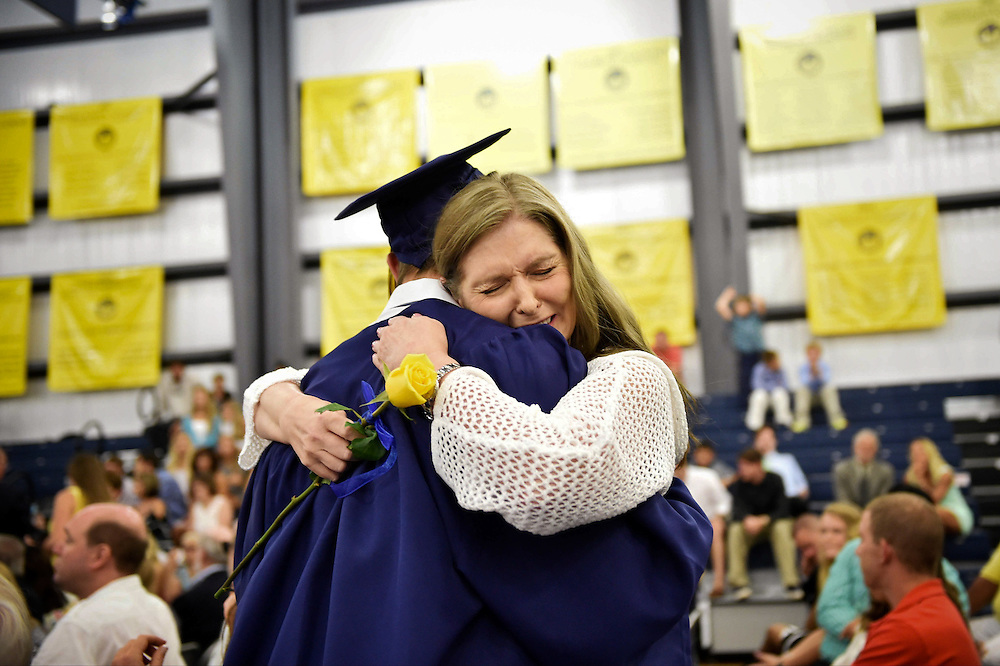 "Xavier Mascareñas/Treasure Coast Newspapers; Natalia Smith, of Stuart, shares an emotional embrace with her son, graduating senior Geoffrey Smith, during the commencement ceremonies at The Pine School in Hobe Sound on May 30, 2015. ""It's the proudest day of my life. I'm so happy for him, proud of him,"" she said."