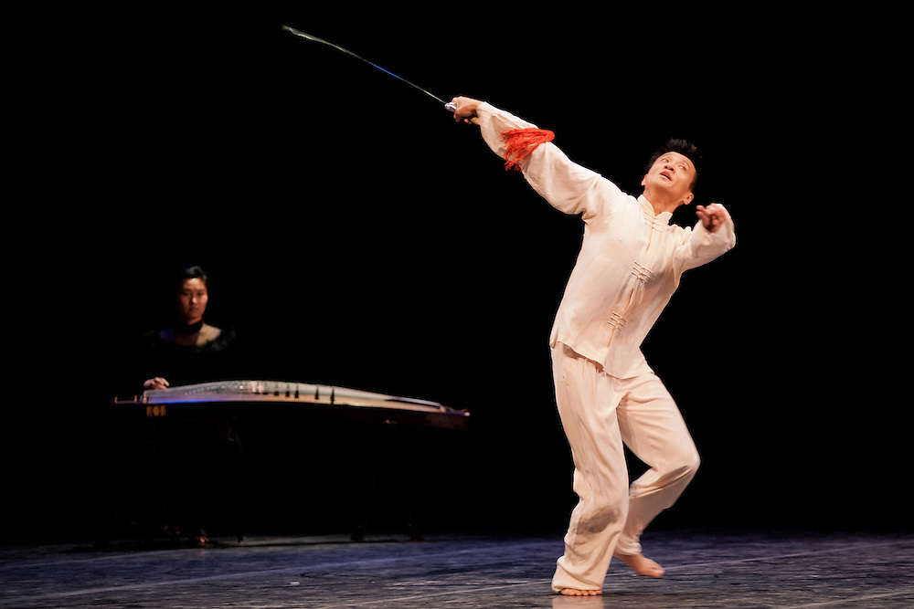 "Chengxin Wei and Luwen Zhang perform a piece entitled ""The Spirit of Tai Chi Sword"" during a dress rehearsal for the third annual Global Excusions World Music and Dance Festival, which was held in the Templeton-Blackburn Alumni Memorial Auditorium on Saturday. Photo by: Ross Brinkerhoff."