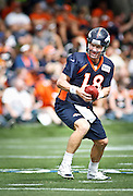 SHOT 7/25/13 9:44:12 AM - Denver Broncos quarterback Peyton Manning #18 runs through drills during opening day of the team's training camp July 25, 2013 at Dove Valley in Englewood, Co.  (Photo by Marc Piscotty / © 2013)