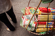 Incense sticks and votive papers in a basket of a street vendor, Hanoi, Vietnam, Southeast Asia