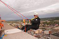 Dayton Area Chamber of Commerce president & CEO Phil Parker goes 'Over The Edge' of the KeyBank building, part of the fall Urban Nights in downtown Dayton, Friday, September 14, 2012.