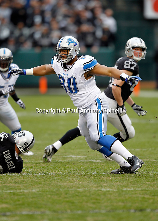 Detroit Lions defensive tackle Ndamukong Suh (90) chases the action during the NFL week 15 football game against the Oakland Raiders on Sunday, December 18, 2011 in Oakland, California. The Lions won the game 28-27. ©Paul Anthony Spinelli