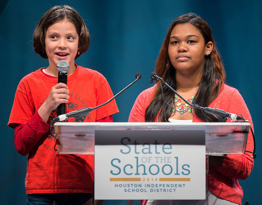 Renata Bolado Corona, left, of the Mandarin Chinese Language Immersion Magnet School and Kennedy Garrett, right, of the Wharton Dual Language Academy introduce Superintendent Dr. Terry Grier during the Houston ISD State of the Schools luncheon at the Hilton of the Americas, February 26, 2014.