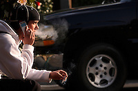 BELMONT, CA- JANUARY 24: Derek Schlesinger, 18 has a cigarette as he waits for his girlfriend to pick him up on January 25, 2007 in Belmont, California.  (Photograph by David Paul Morris)