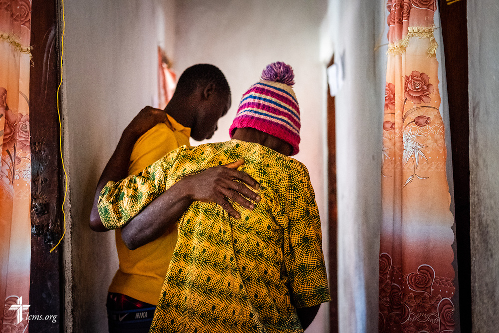 A patient is helped to a treatment consultation room on the fifth day of the LCMS Mercy Medical Team on Friday, May 11, 2018, in the Yardu village outside Koidu, Sierra Leone, West Africa. LCMS Communications/Erik M. Lunsford