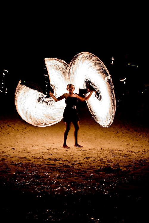 Fire dancer performs on beach in Roatan, Honduras. Copyright 2010 Reid McNally.